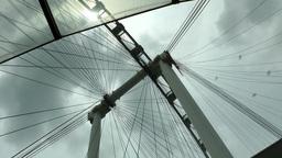 Singapore 006 ferris wheel spokes against cloudy sky Footage