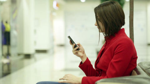Typing woman on a smartphone device Footage