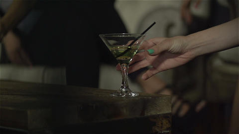 Beautiful woman take cocktail in the club. Slow motion Footage