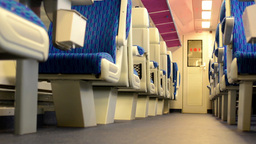 train - interior - seats - first class - door in the background Footage