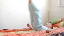 child(little boy) jumps on the bed- kid jumping Footage
