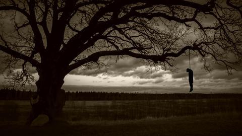 hanged man on gloomy background Footage