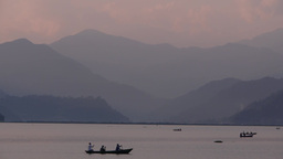 3 people in a rowing boat on Lake,Pokhara,Nepal Footage