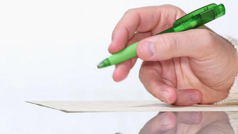Young Man Writing by Hand with a Pen Stock Video Footage