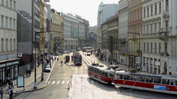 urban street with people, cars, trams - modern buildings - road and pavement - s Footage