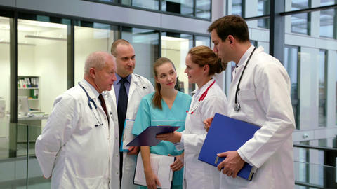 Team of doctors discussing over medical report Footage