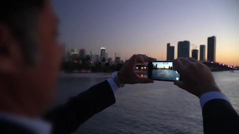 man Taking Smartphone Picture,sunset Miami Travel