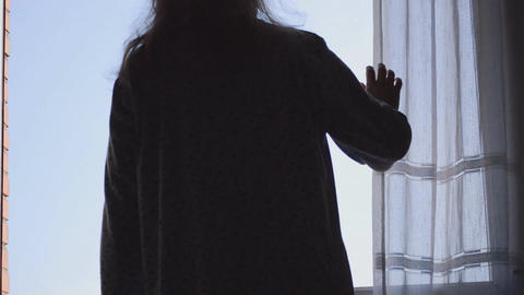 Woman Looks Out of Window Footage