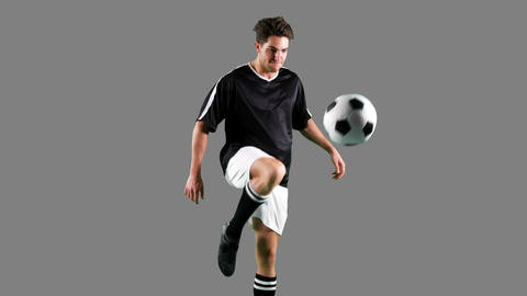 Determined athlete practicing football Live Action