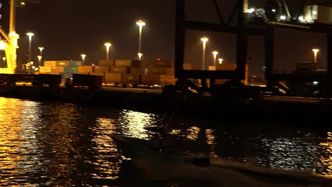 The night speed boat is moving to the port Footage
