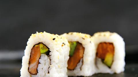 Uramaki sushi served on grey stone slate Live Action