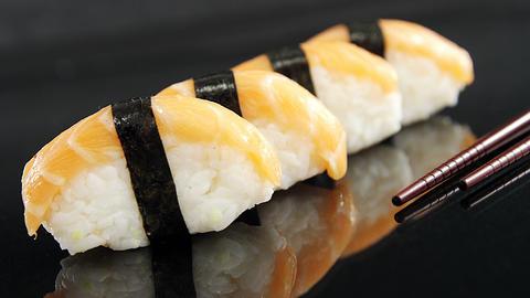 Nigiri sushi wrapped in nori seaweed Live Action