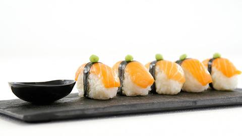 Nigiri sushi served on black stone slate Live Action