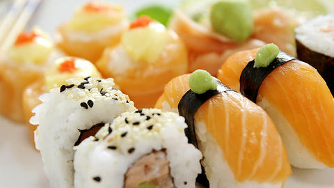 Set of assorted sushi served on black stone slate Live Action
