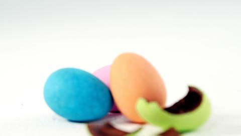 Broken chocolate Easter egg against three chocolate Easter eggs Footage