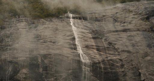 Narrow Waterfall In Fog, Norway - Cinematic Style