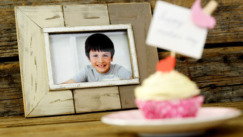 Close-up of delicious cupcake with happy mothers day label Live Action