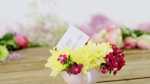 Happy mother day card on flowers Live Action