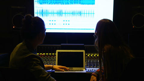 Audio engineers using laptop while mixing sound Footage