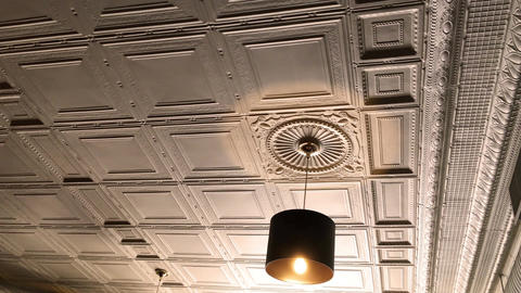 Overhead golden light in victorian restarant against beautiful ceiling Footage