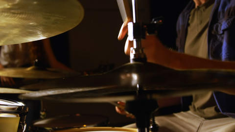 Drummer playing drum in studio Live Action
