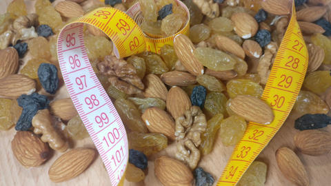 Tape measure almonds walnuts and raisins