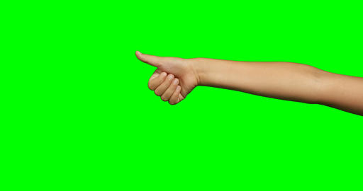 Person making hand gesture of thumbs up against green screen background Live Action