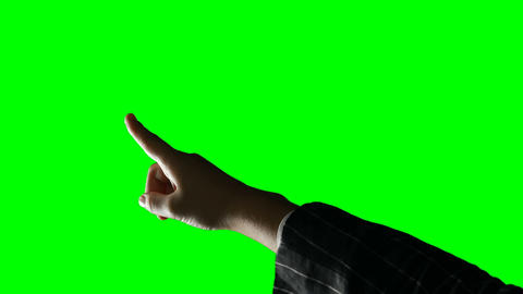 Person making hand gesture against green screen background Live Action