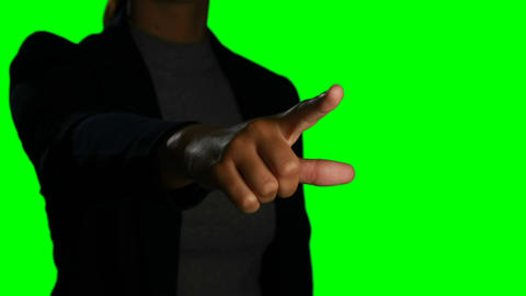 Woman making hand gesture against green screen background Live Action
