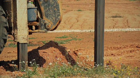 Tractor with a drilling device at a construction site Filmmaterial