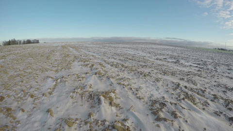 Clouds running over snowy field, time lapse 4K Footage