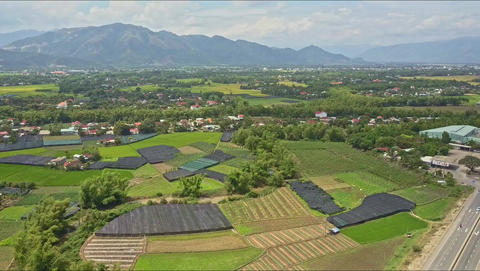 Aerial View Villages among Fields Trees against Mountains Footage