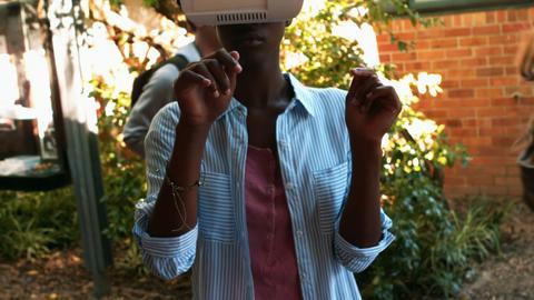 Schoolgirl wearing vitality headset Footage