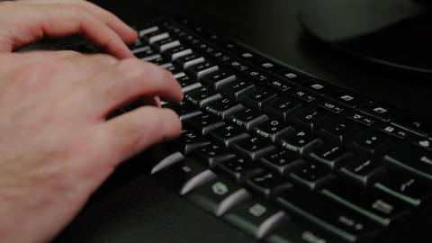 Man typing on a keyboard with letters in Hebrew and English - Wireless keyboard Footage