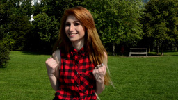 Young attractive woman is in the park - she is happy and smiles - fell joy (rejo Footage