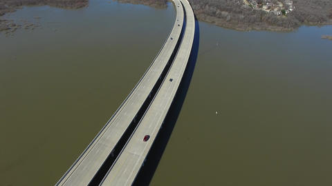 Aerial video of cars traveling on bridge over Hickory Creek Footage