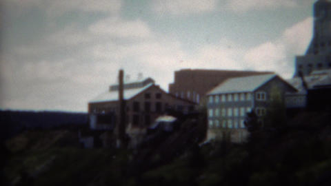 1953: Hilltop mining processing factory complex with warehouse buildings Footage