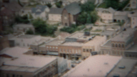 1953: Downtown hillside view of famous town and main street buildings Footage