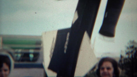 1966: Women walking past tour bus visiting the museum Footage