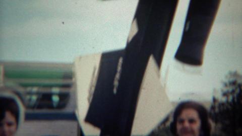 1966: Women walking past tour bus visiting the museum Footage