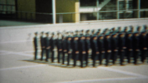 1966: Soldiers marching in formation across the military complex grounds Footage