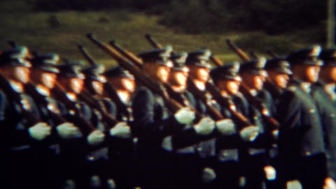 1966: Armed soldiers marching in perfect sync with shouldered rifle guns Live Action