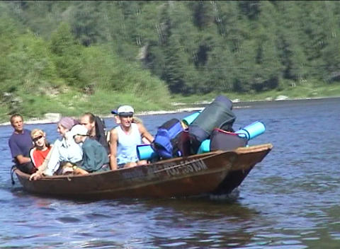 Tourists are transported through river Tom Footage