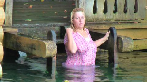 Elderly woman bathes in Sarov St.Seraphim Source Footage