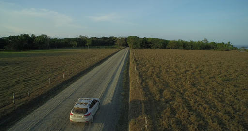 Aerial view of a car travelling down a country road - Puerto Jiménez, Costa Ric Footage