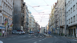 urban street with people, cars, trams - modern buildings - road and pavement Footage