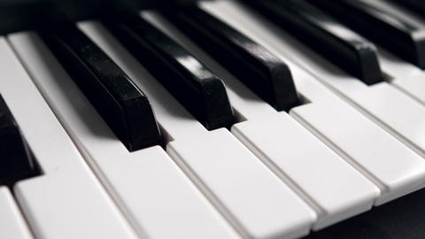 Black and white piano keys on the keyboard Live Action