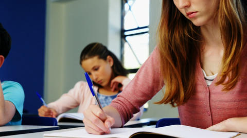 Students doing homework in classroom Live Action
