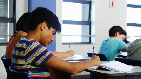 Students doing homework in classroom Footage