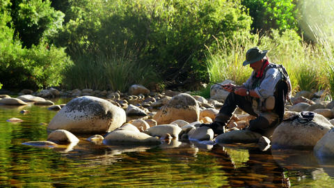 Man fly fishing in river Live Action